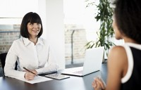 Female business woman interviewing a woman for a job
